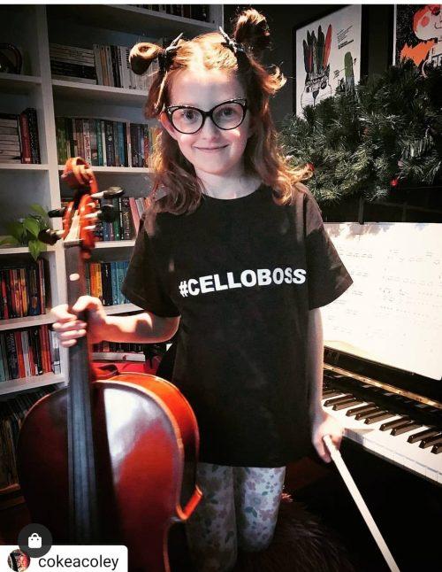 girl wearing celloboss t-shirt holding a cello