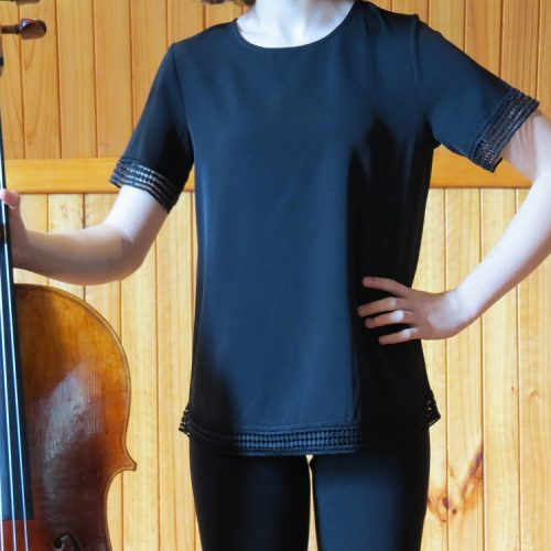 girl-holding-cello-black-top-and-pant