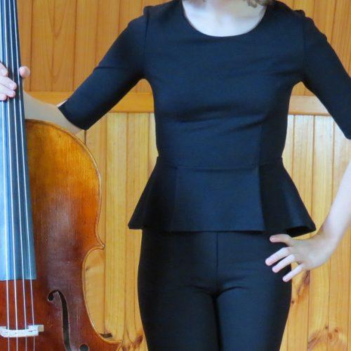 girl_wearing_black_peplum_top_with_cello