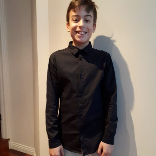 boy wearing a buttoned black shirt
