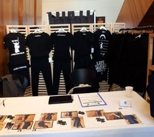 cadenza-apparel-black-clothes-display
