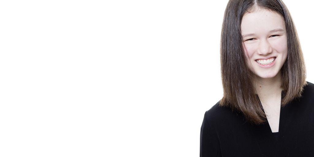 girl-smiling-wearing-black-blouse