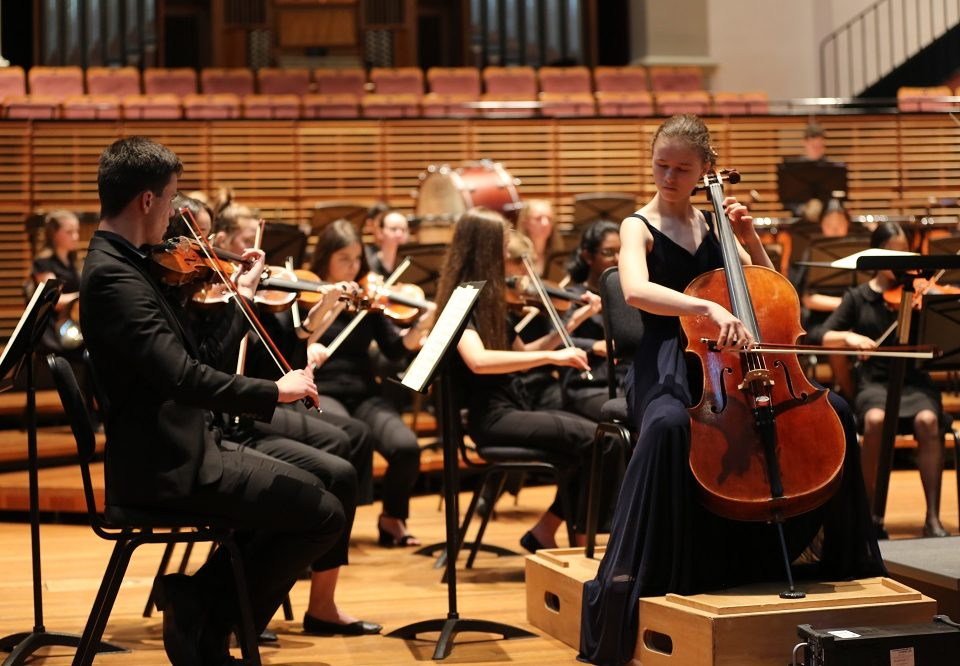 cellist-solo-performing-with-orchestra