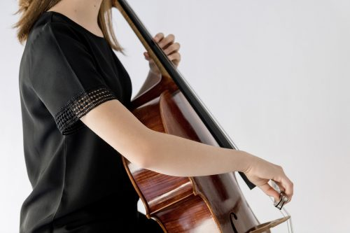 girl playing cello with black blouse