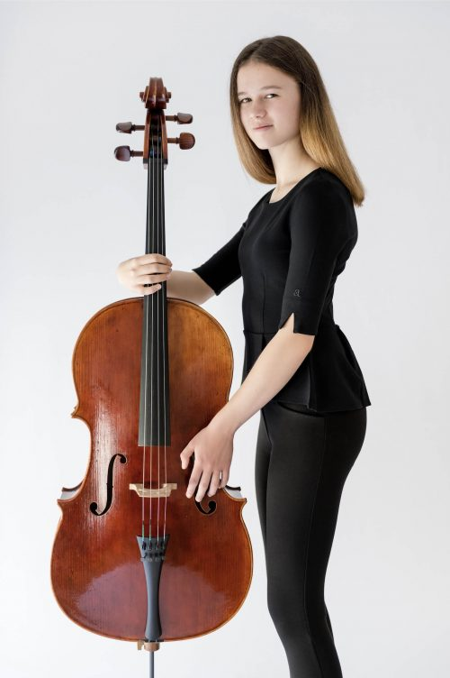 girl standing with cello