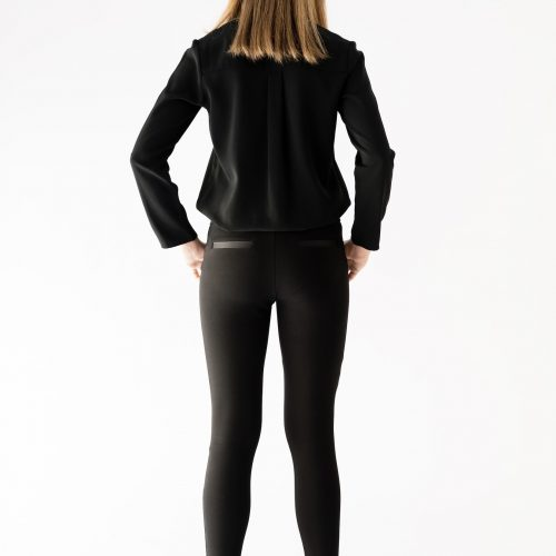 girl standing wearing black pant and blouse