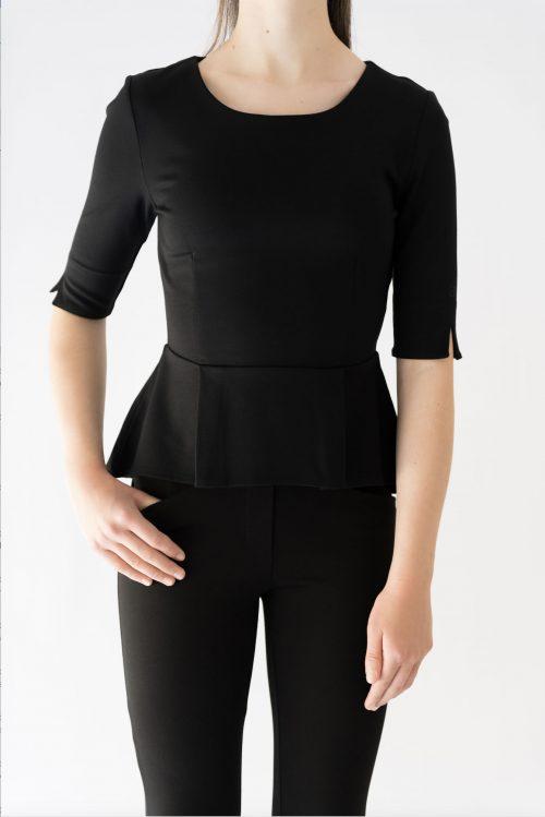 girl wearing black peplum top and black pant