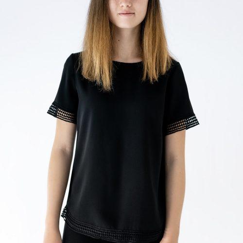 girl wearing black top and black pants