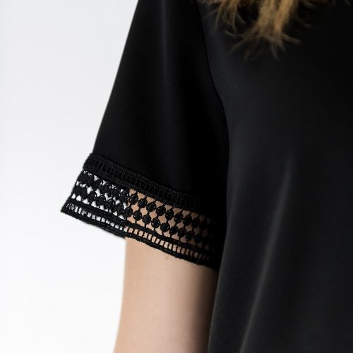 close up of lace detail on sleeve