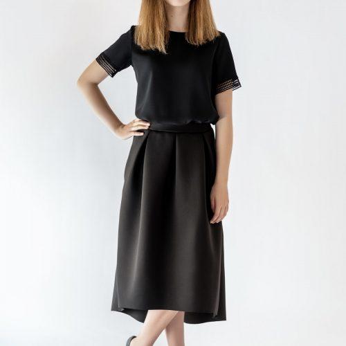 girl standing wearing black skirt and black blouse