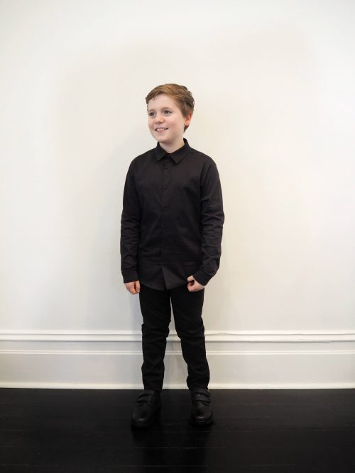boy wearing black long sleeved shirt