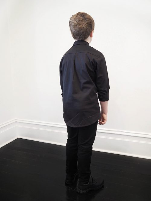 boy wearing black slim fit shirt back view